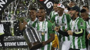 Team members of Colombia's Atletico Nacional celebrate after winning the Copa Libertadores in Medellin, Colombia, Wednesday, July 27, 2016. Atletico defeated Ecuador's Independiente Del Valle and proclaimed themselves champions. (AP Photo/Dolores Ochoa)